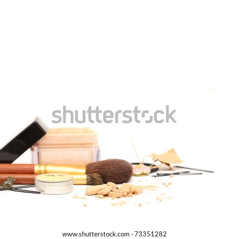 Powder and women accessories: cosmetic, jewelry, hairpins isolated. Shallow depth of field - stock photo