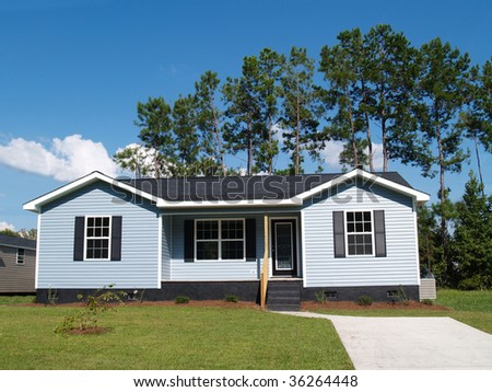 Powder blue low-income single-story home with porch. - stock photo