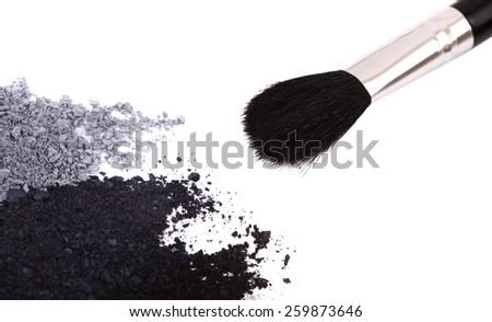 Powder eyeshadow makeup and brush on a white background - stock photo
