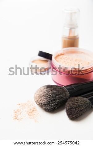 Powder, foundation and brushes isolated on the white background - stock photo