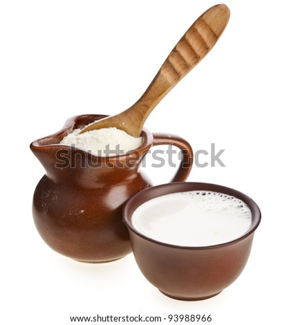 powder milk drink  in  clay  pitcher and cup on white background