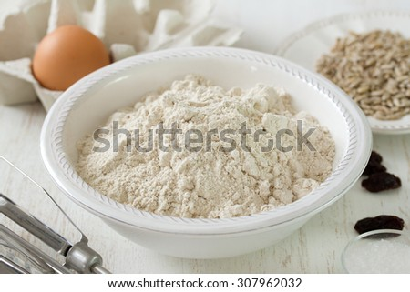 powder on white plate on blue wooden background