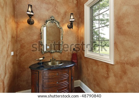 Powder room in luxury home with oval sink