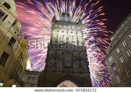 Powder tower (gate) at evening and holiday fireworks in Prague, Czech Republic. It is one of the original city gates, dating back to the 11th century. It is one of the symbols of Prague