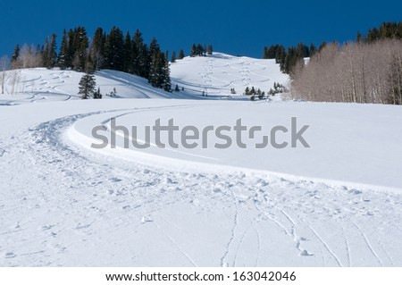 powder turns on anonymous mountain - stock photo