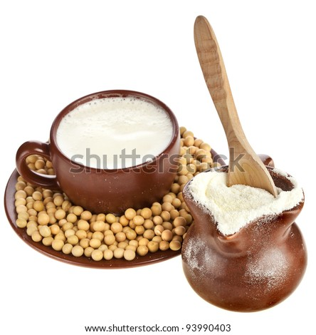 powdered milk drink in clay pitcher , soy beans  and a clay cup on white background - stock photo