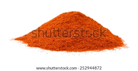 Powdered red pepper pile from top on white background  - stock photo