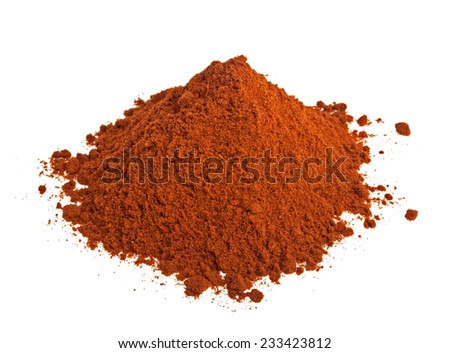 Powdered red pepper pile on white background