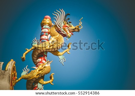 Power and colorful from dragon statue in temple