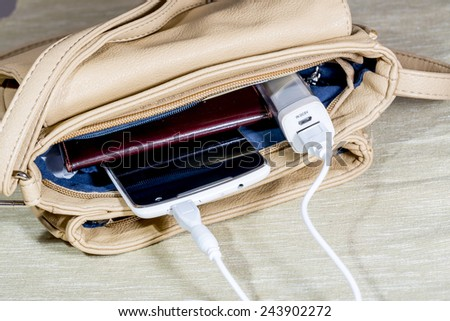 Power-bank in the woman`s bag.