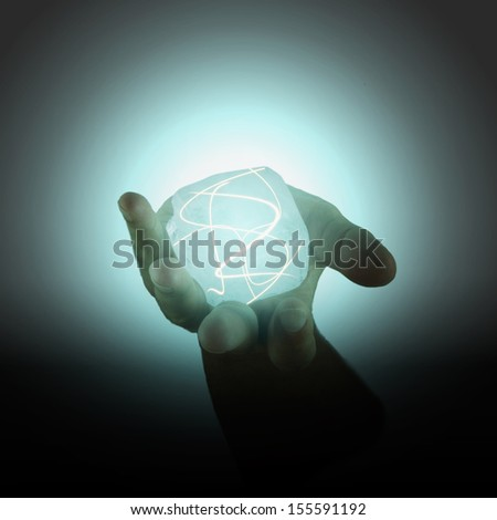 Power cube with lights held in a male hand - stock photo