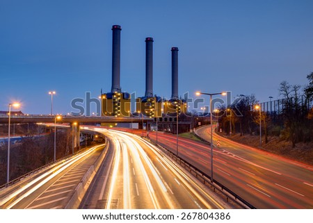 Power generating plant and a highway at night - stock photo