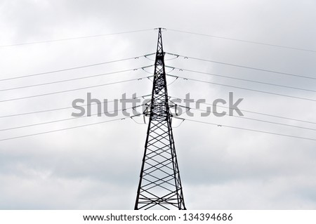 Power line against the background of the cloudy sky.
