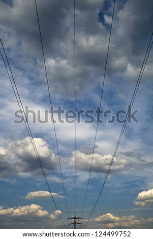 power line against the blue sky - stock photo