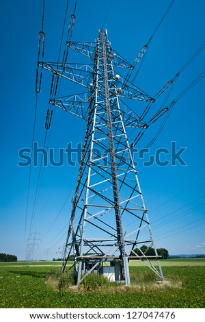 Power Line in a Summer Landscape with Blue Sky - stock photo