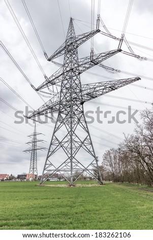 Power line near a village. - stock photo