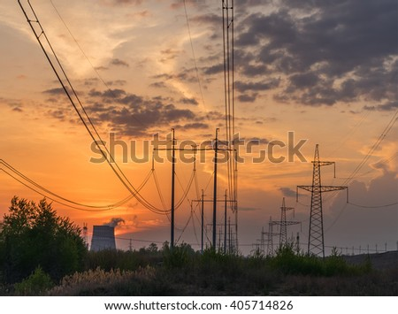 Power line of a nuclear power station, sunset - stock photo