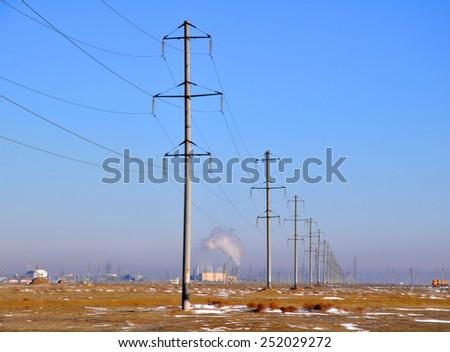 Power line poles - stock photo