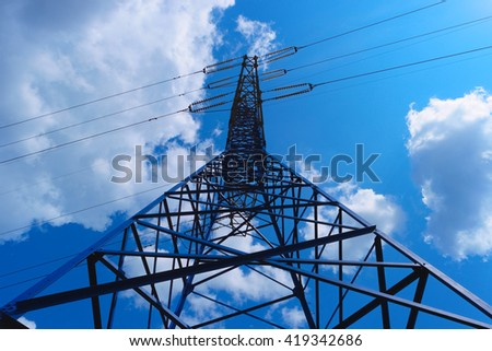 Power line tower on blue sky background - stock photo
