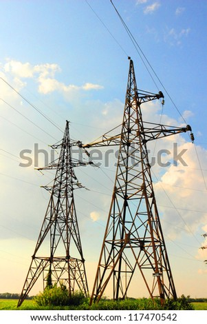 Power lines against blue sky