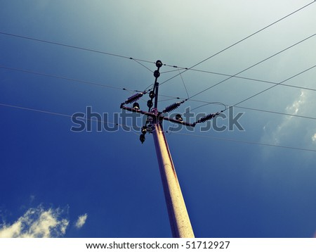 POWER LINES AND ELECTRIC PYLONS WITH SKY - stock photo