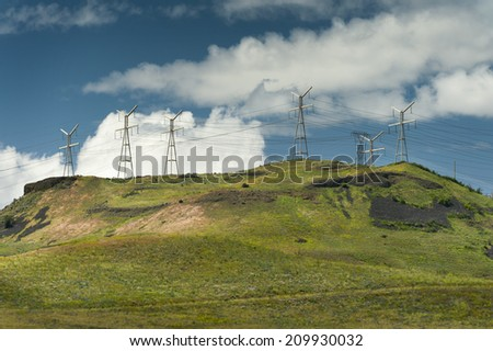 Power Lines and Hills. Power transmission lines from Grand Coulee dam and the Columbia River run across the palouse area of eastern Washington state. - stock photo