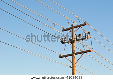 Power lines and pole - stock photo