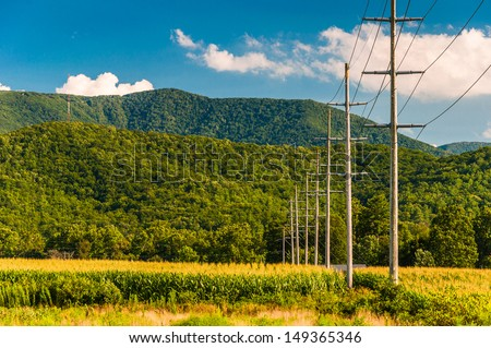 Power lines and view of the Blue Ridge Mountains in the Shenandoah Valley, Virginia. - stock photo