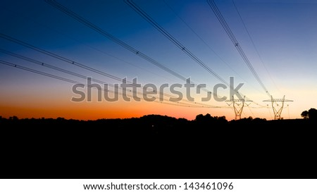 Power lines at dusk, delivery power to Australian communities