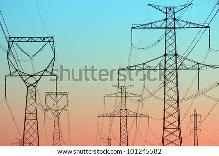 Power lines in the morning light - stock photo