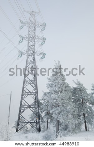 Power lines in winter scenery, Finland - stock photo