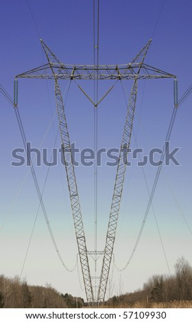 Power Lines Supported by V Shaped Towers Passing Through a  Wooded Area