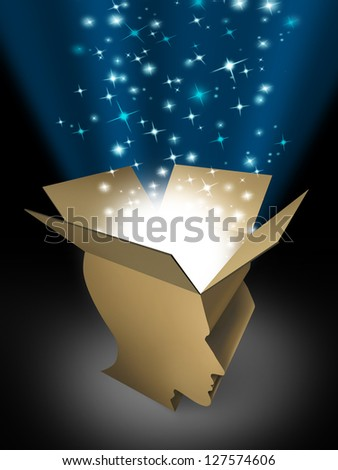 Power of the mind as powerful intelligence with an open box in the shape of a human head illuminated with a glowing beaming light bursting with sparkles as a symbol of human creativity and potential. - stock photo