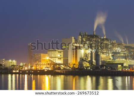 Power plant along the coast at night in Hong Kong - stock photo