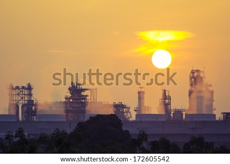Power plant and cooling tower with sunrise background.