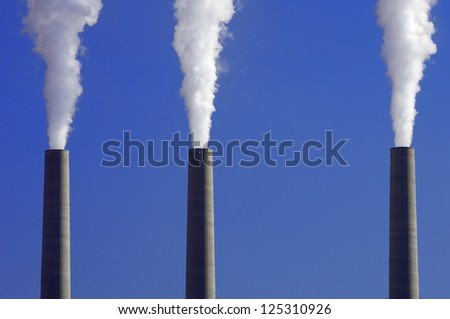power plant emissions to the atmosphere - stock photo