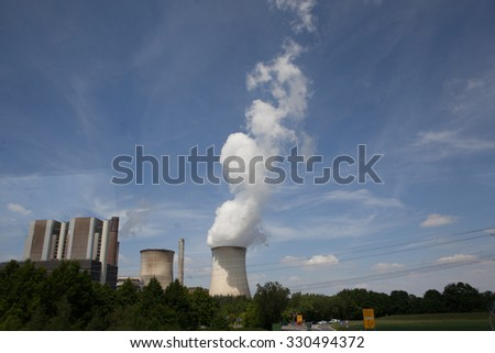 Power plant, field of photovoltaic panels and wind turbines, Germany