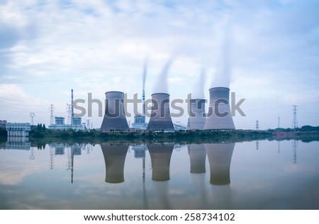 power plant in riverside , a row of cooling tower with the reflection