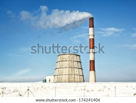 Power plant in winter sunny day - stock photo