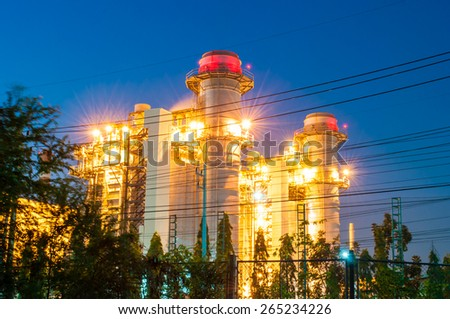 power plant on blue sky background. - stock photo