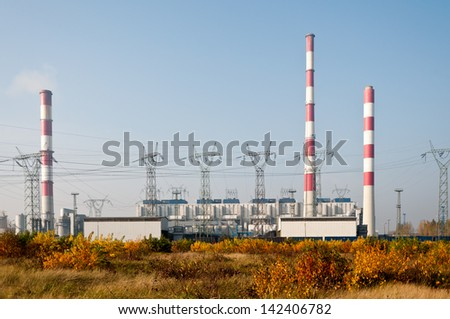 Power plant pylons and transmission power lines - stock photo