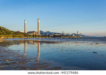 Power plant reflection at sunset - stock photo