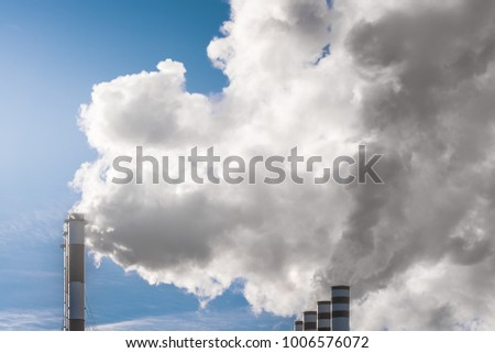 power plant smokes. air pollution.