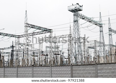 Power plant - transformation station. Multitude of cables and wires.