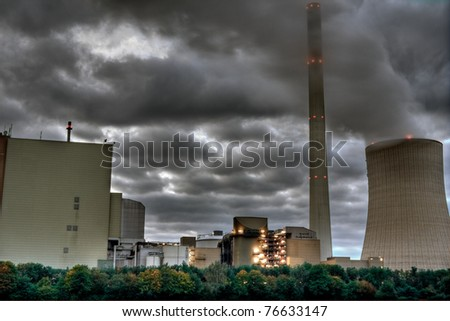 Power plant under a cloudy sky. - stock photo