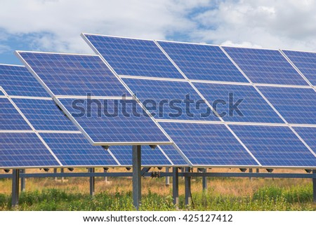 Power plant using renewable solar energy with blue sky.