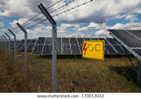 Power plant using renewable solar energy with warning sign: Danger and copy-space - stock photo