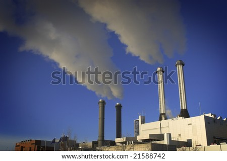 power-plant with smoking chimneys. Heavy industry - stock photo