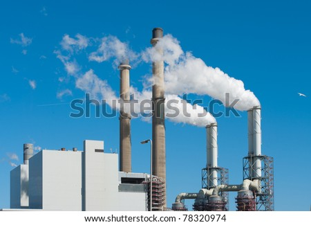 power plant with smoking chimneys in Rotterdam, Netherlands - stock photo