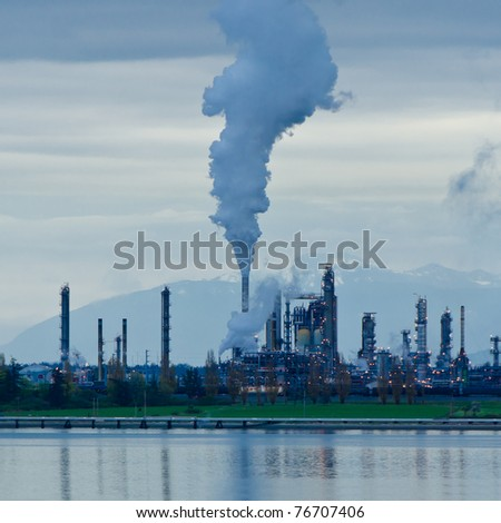 Power plants generating smokes at dusk. - stock photo